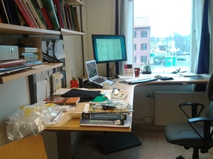 Fig. 1 My messy desk and full download folder.