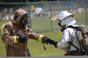 A_member_of_the_Marine_Corps_Air_Station_Beaufort_fire_department_is_helped_out_of_his_HAZMAT_suit_as_he_goes_through_a_decontamination_center_at_the_sight_chemical_spill_at_the_training